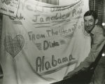 "James G. Pirie with a ""Welcome Home"" banner from Alabama that he received after being..."