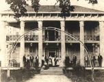 Family gathered on the front porch of the house on the Thompson homestead in Tuskegee, Alabama.