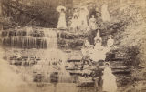 Group of men, women, and children beside a small waterfall in Florence, Alabama.