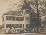 Students standing in front of the public school in Whistler, Alabama.