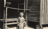 Elderly woman sitting in front of a cabin in Sylacauga, Alabama.