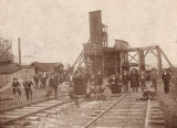 Men, women, and children gathered on the tracks at McDonald Mines in Carbon Hill, Alabama.