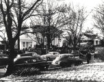 Cars and crowds of people outside the Governor's Mansion in Montgomery, Alabama, during the...