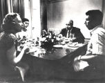 Governor Persons with his wife and children, eating in the breakfast room at the Governor's...