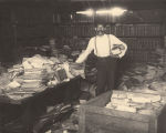 George Doak moving unprocessed archival material in the basement of the Capitol in Montgomery,...