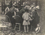 Oscar Wilder Underwood talking to young girl at a political luncheon on the grounds.