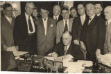 President Franklin Roosevelt signing the Norris-Hill Act, which created the Tennessee Valley...