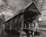 Close-up of Mellon Covered Bridge over Choccolocco Creek, east of Oxford, Alabama, near Sunny Eve...