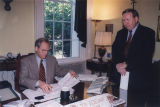 Governor Don Siegelman looking over paperwork at his desk in his office at the Capitol in...