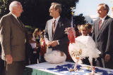 Bill Bates, Governor Don Siegelman, Clyde the Turkey, and Representative Seth Hammett at the...