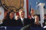 Governor Don Siegelman with his wife, Lori, and his daughter, Dana, at his inauguration in...