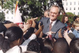 Governor Don Siegelman shaking hands with children at the annual turkey presentation from Bates...