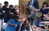 Children shaking hands with Governor Don Siegelman.