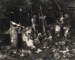 Alcoholic Beverage Control agents beside stills in Macon County, Alabama.