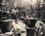 Group gathered around a still in Lee County, Alabama.