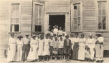 African American students outside a school building in Pickens County, Alabama.