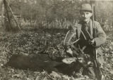 Hunter with an eight-point buck killed in the Black Warrior National Forest.