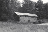 Side of Lidy's Covered Bridge, at Liddy's Lake, eight miles east of Cullman, Alabama, near the...