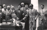 President Lyndon Johnson signing the act that established the National Technical Institute for the...
