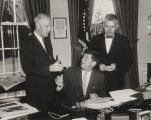 Lister Hill in the Oval Office as President John F. Kennedy signs a bill.