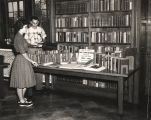 "Huntingdon College students Nevelle Vaughn and Turpin Ashurst looking at books donated ""in..."