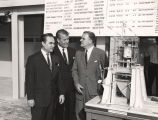 Governor George Wallace, Dr. Wernher von Braun, and Dr. James E. Webb examining a model at...