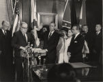 Albert Brewer taking the oath of office as governor of Alabama at 1:00 in the afternoon.