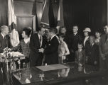 Governor Albert Brewer shaking hands with George Wallace after taking the oath of office.