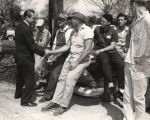 George Wallace shaking hands with working men during a gubernatorial campaign.