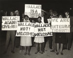 African Americans holdings signs to protest George Wallace in Gary, Indiana.
