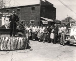George C. Wallace making a speech to a group of students in a small town during a gubernatorial...