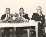 John Patterson, George Wallace, and J. O. McCollough seated together at a table.