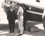 John Patterson and an army officer standing outside an airplane.