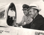 John Patterson and an army officer sitting in a military aircraft.