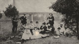 Group eating watermelon on a riverbank in Wetumpka, Alabama.