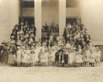 Congregation standing on the front steps of the Autaugaville Methodist Church in Autaugaville,...