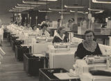 Women operating mangles at a textile mill in Alabama.