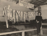 "Woman standing beside fish caught at ""Baldwin County's Speckle Trout Rodeo."""