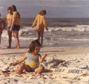 Little girl playing in the sand at Gulf Shores, Alabama.