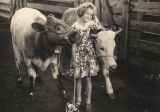Young girl with two calves at a livestock show in Montgomery, Alabama