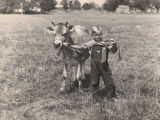 Larry Easterwood of Randolph County, Alabama, with his prize-winning calf at the Demopolis Dairy...