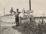 Boy holding up fish he has caught in the Tennessee River at U.S. Highway 31 in Decatur, Alabama.