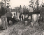 People fishing in a river or lake in Alabama.