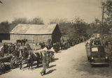 Mules and wagons lined up along the road at the Turkey Carnival in Uniontown, Alabama.