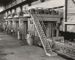 Employees operating machinery at the Republic Steel Corporation plant in Gadsden, Alabama.