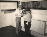 "D. W. King and A. M. Reilly inspecting berries frozen in the ""Spot Freezer"" at the..."