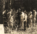 Brooks Toler, Alabama state forester, examining a pine tree with a group of boys from the 4-H...