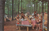 Families eating at a picnic table at Rickwood Caverns Park in Warrior, Alabama.