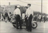 Three policemen watching marchers in Montgomery during the Selma to Montgomery March.