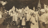 Children preparing to march in the Red Cross parade in downtown Montgomery, Alabama, during World...